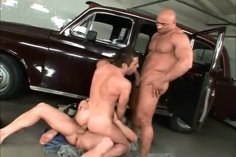 Three  pumped up Car Mechanics nailed naked