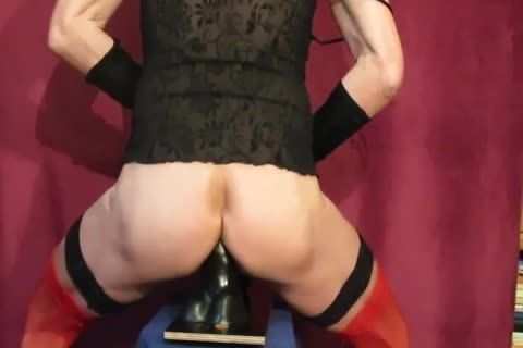 Crossdresser Riding black dildo With cum